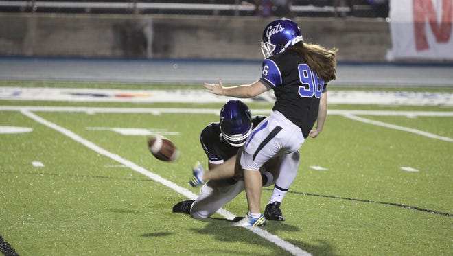 Meridian's Kelly Bator kicks and extra point