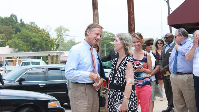 Tennessee Gov. Bill Haslam greets Brownsville residents before announcing a grant for the city Wednesday at Tamm Park.