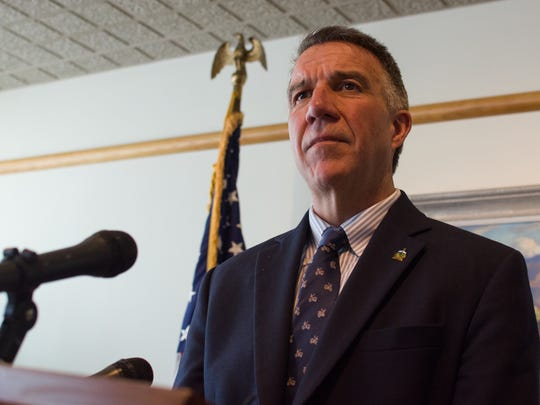 Gov. Phil Scott speaks to reporters at his Montpelier