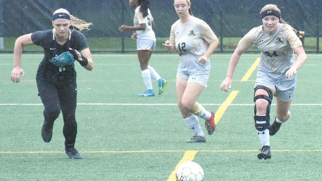 Herkimer College All-America Keara Blumenstock (right) makes a run up the field during an Oct. 31, 2019, Region III playoff match against Finger Lakes Community College. Blumenstock, a Poland High School graduate, is returning for her sophomore soccer season which will now be played in the spring because of the coronavirus pandemic.