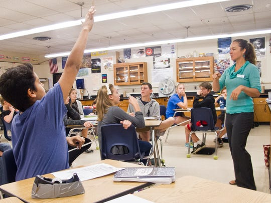 Diego Gonzalez, an eighth-grader at Tuttle Middle School in South Burlington, shoots up his hand during a Q&A session moderated by Vermont Energy Education Program instructor Mariah Keagy. The one-day lab, hosted by Amelia Lutz' science class, was held in late September.