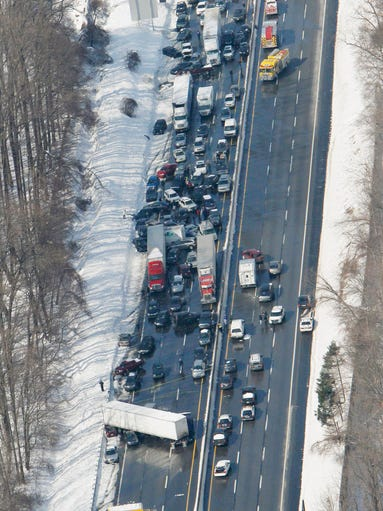 A huge pileup, seen in an aerial photo, shut down part of the Pennsylvania Turnpike in Bensalem, Pa., on Friday. An estimated 50 to 100 vehicles were involved after crashes on the slushy roadway.
