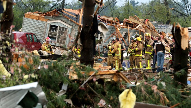 Firefighters work the site of the damage after a tornado ripped through Prairie Lake Estates trailer home park, just north of Chetek, Wis., Tuesday, May 16, 2017.