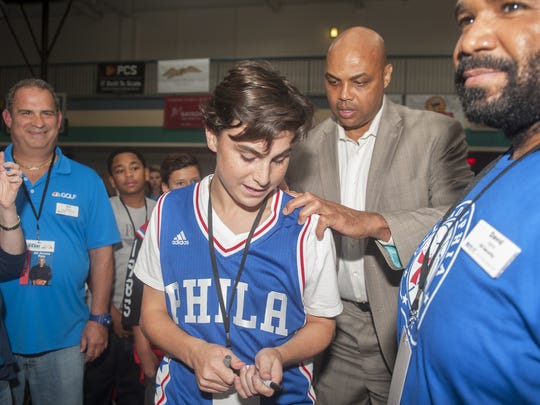Charles Barkley, a former Philadelphia 76ers player and NBA Hall of Famer, gives his autograph to Jared Keim, 16 of Voorhees, shortly after Barkley arrived to the Katz JCC Sports Award Dinner in Cherry Hill on Monday evening.  Barkley was the keynote speaker of the event.