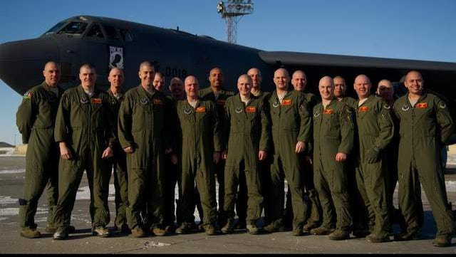 Members of the 23rd Bomb Squadron, Minot Air Force Base, N.D., pose with their bald heads.