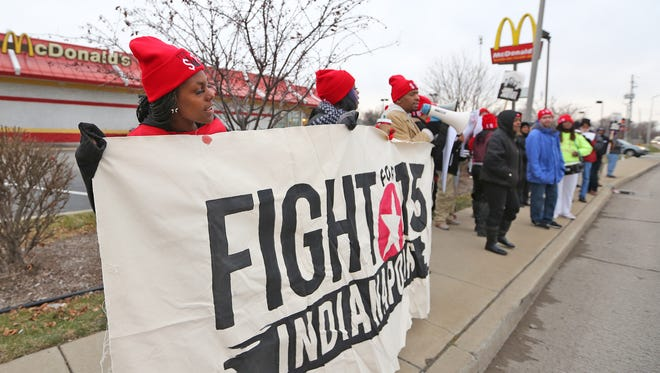 Workers and supporters are shown protesting for a higher minimum wage of $15 an hour ion Dec. 4, 2014, outside of  the McDonald's in the 3700 block of Post Road. Legislation to raise the state's minimum wage is before the Indiana General Assembly for the 2015 session.