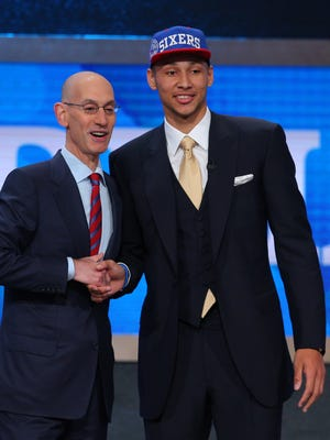 Ben Simmons (LSU) greets NBA commissioner Adam Silver after being selected as the No. 1 overall pick to the Philadelphia 76ers in the NBA draft.
