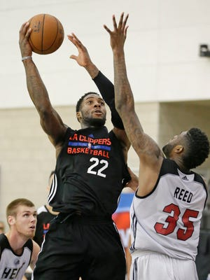 Los Angeles Clippers forward Branden Dawson (22) takes a shot over the Miami Heat's Willie Reed on Wednesday, July 8, 2015, in Orlando.