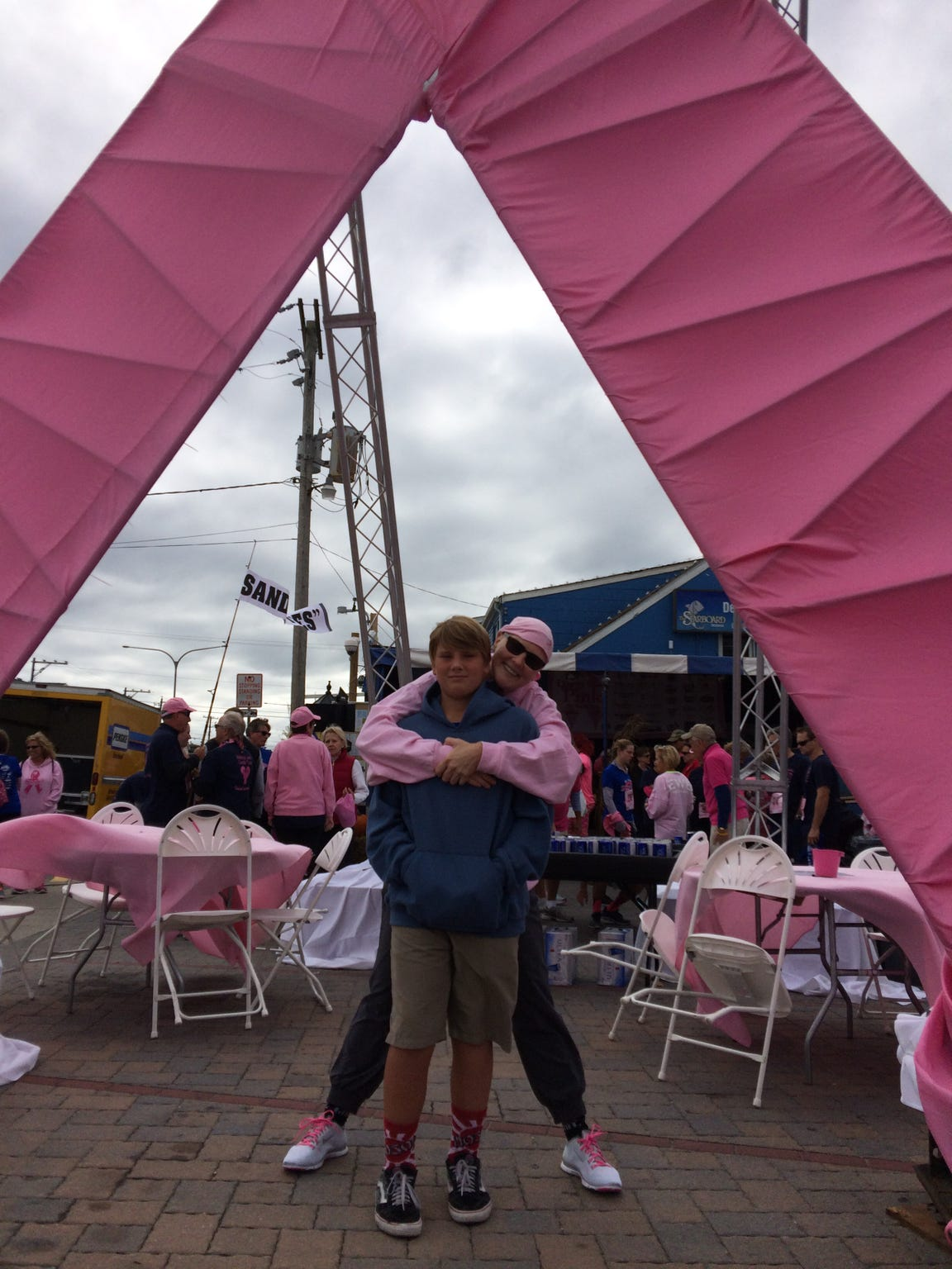Lisa Welling poses for a photo with her son Louis during Dewey Goes Pink.