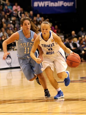 Abby Owings drives to the basketball for Thomas More College against Tufts' Lauren Dillon April 4