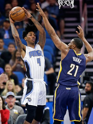 Orlando Magic's Elfrid Payton (4) passes the ball as Indiana Pacers' Thaddeus Young (21) blocks his path to the basket during the first half of an NBA basketball game, Wednesday, Feb. 1, 2017, in Orlando, Fla.
