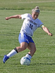 Howards Grove's Brittany Schiller (11) prepares to