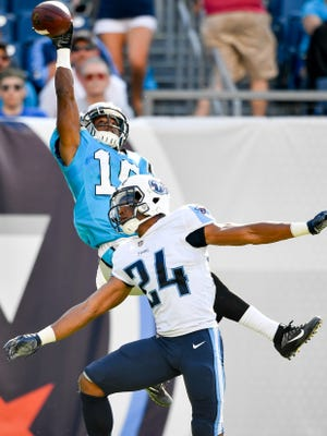 Carolina Panthers wide receiver Austin Duke (16) misses a catch over Tennessee Titans defensive back Kalan Reed (24) during the second half of the preseason NFL game at Nissan Stadium in Nashville, Tenn., Saturday, Aug. 19, 2017.