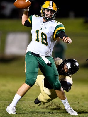 Gallatin's Ander Sloan (18) takes a hit from Mt. Juliet's Marcello Walton (28) during the second half at Mt. Juliet High School in Mt. Juliet, Tenn., Friday, Sept. 8, 2017.