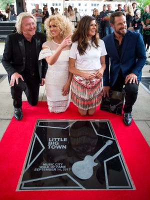 Little Big Town view their star during an induction ceremony at Music City Walk of Fame Park in Nashville, Tenn., Thursday, Sept. 14, 2017.