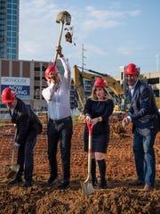 Sir. Richard Branson flips his dirt behind him as Mayor