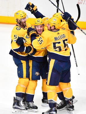 Nashville Predators defenseman Samuel Girard (94) celebrates with teammates after scoring his first NHL goal during the second period against the Dallas Stars at Bridgestone Arena in Nashville, Tenn., Thursday, Oct. 12, 2017.