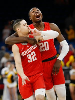Houston Cougars guard Rob Gray (32) and teammate Gabe Grant (20) celebrate their win over Wichita State.