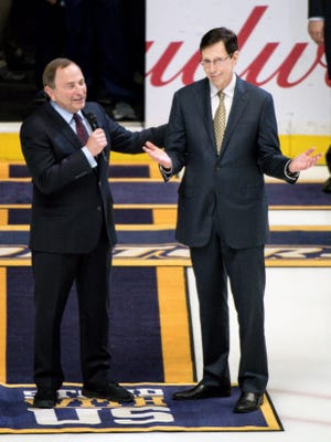 MaR. 9, 2018: NHL Commissioner Gary Bettman, left, speaks about Nashville Predators President of Hockey Operations/General Manager David Poile during a ceremony recognizing Poile for becoming the winningest general manager in NHL history before a game against the Anaheim Ducks Bridgestone Arena, Thursday, March 8, 2018, in Nashville, Tenn.