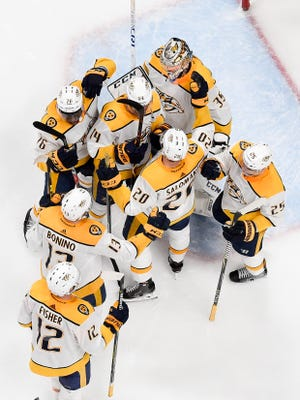 Nashville Predators goaltender Pekka Rinne (35) celebrates with teammates after their victory against the Colorado Avalanche in game 6 of the first round NHL Stanley Cup Playoffs at Pepsi Center, Sunday, April 22, 2018, in Denver, Colo.