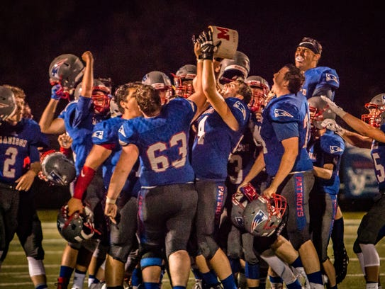 The Patriots lift the Jug following their 42-20 victory