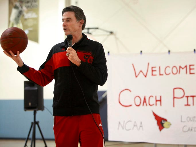 Louisville Cardinals Basketball coach Rick Pitino speaks to children at the Boys and Girls Club Stalnaker Unit on Tuesday, April 22, 2014.