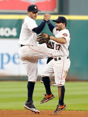 The Astros may have the best middle infield combination in the majors with shortstop Carlos Correa, left, and second baseman Jose Altuve.