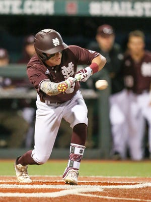 Mississippi State's Hunter Stovall bunts for a base hit during the Bulldogs' season opener on Friday against Texas Tech.