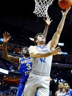 University of Memphis forward Jake McDowell (front) drives to the basket against McNeese defender Richard Laku (back) during first half action at the FedExForum.