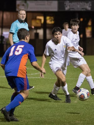 Nelson Libbert (9) controls the ball during the boys regional final soccer match between Pensacola Catholic and Jacksonville Bolles at Pensacola Catholic High School on Wedneday, February 14, 2018.