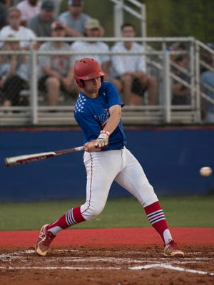 Pace High School's Dalton Childs makes contact with the Tate pitch during the Region 1-7A championship game Tuesday night.