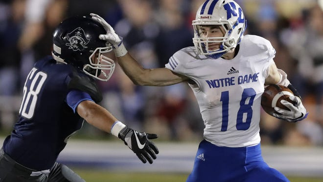Green Bay Notre Dame running back Mike Gregoire will play football at Wisconsin.