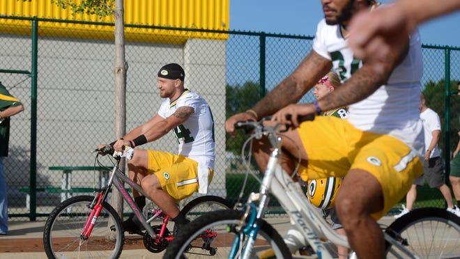 Green Bay Packers wide receiver Jared Abbrederis bikes to practice on the second day of training camp at Ray Nitschke Field.