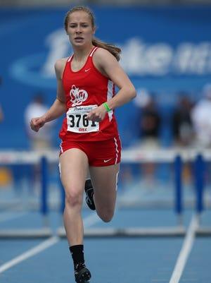 Sarah Plock of Iowa City, City High races in the girls 400 meter hurdles at the Drake Relays on Saturday, April 26, 2014, at Drake Stadium in Des Moines, Iowa.