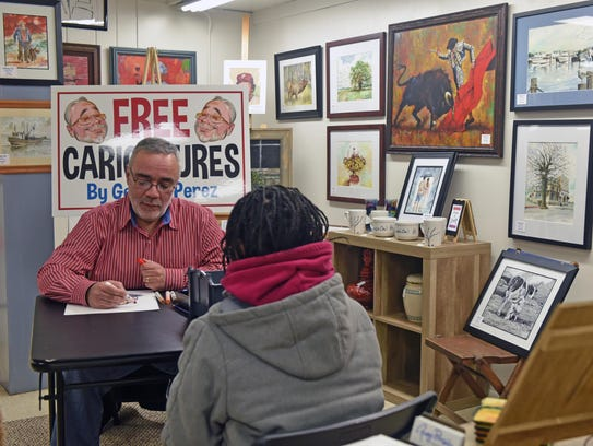George Perez creates free caricatures for people during