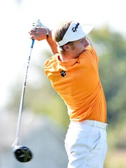Central York's Carson Bacha tees off during the YAIAA