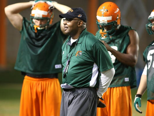 Defensive coordinator Theo Lemon