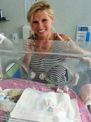 Kim Spratt of Jackson, N.J., celebrates daughter Hayden