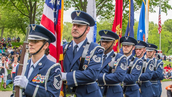 Honor guard prepares to present the colors as part of the Memorial Day service at Ft Custer National Cemetery.