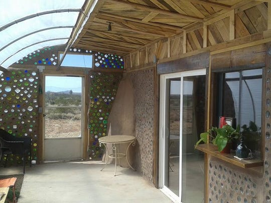 The inside of the greenhouse and patio area of the Earthship.