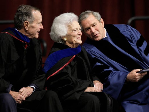 President George W. Bush, right, talks with his parents,