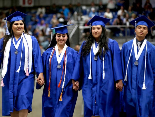 Graduates enter the arena for the McNary High School