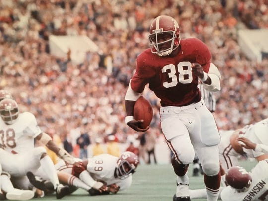 Johnny Lee Davis carrying the ball in his playing days as a fullback for Alabama.