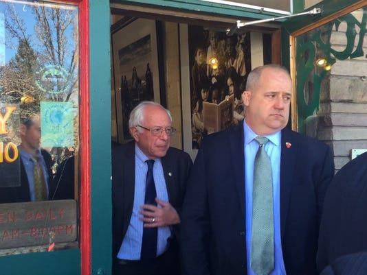 Bernie Sanders exits Macy's European Coffee House in downtown Flagstaff after a surprise visit the morning of Arizona presidential preference election