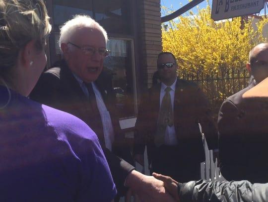 Democratic presidential hopeful Bernie Sanders shakes