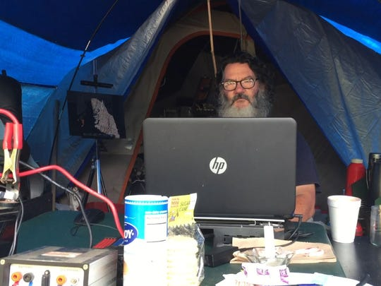 Russell, who has lived at Satoshi Forest for nearly a year, uses solar panels to power his computer and glass engraver.