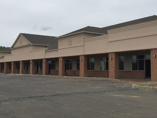 Several storefronts are still vacant at this shopping