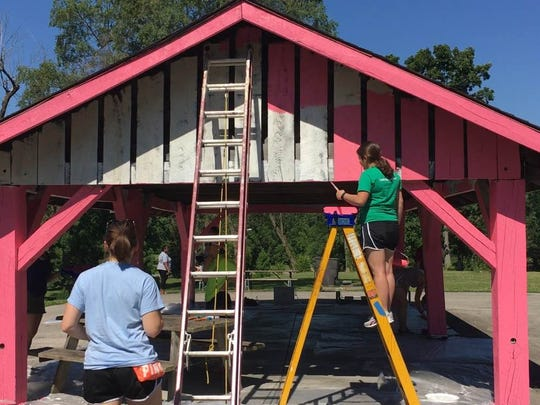 "Volunteers paint one of the shelters at McCulloch Park during the Paint the Park event Saturday, June 25. The event was part of the Whitely Community Council's ""Year in Color"" beautification campaign."