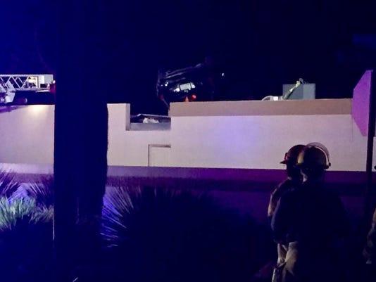 One dead after car crashes, lands on roof