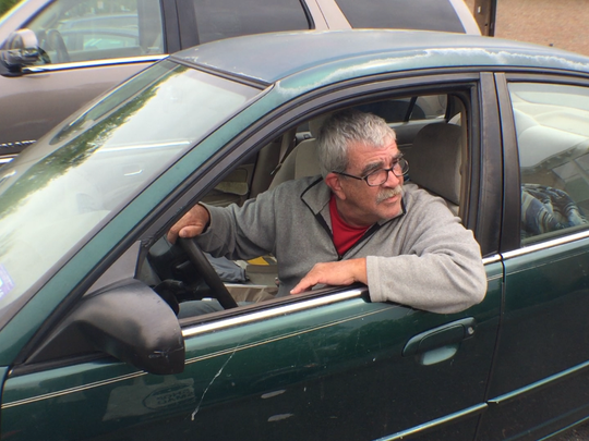 Dean Santos, who lives in his car, missed a payment on a ticket and had his license suspended, making it difficult for him to work.